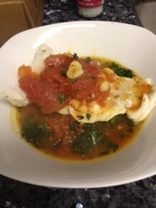 Poached Cod in Tomato Saffron Broth over Spinach